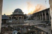 Historic minaret of the Great Umayyad Mosque destroyed in Aleppo