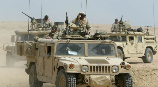 US Army special forces sit on top of their Humvees as they secure important ground in the south of the city of Najaf in central Iraq, March 23, 2003. US infantry and engineers secured the ground after heavy gun fires with Iraqi soldiers during the night. REUTERS/Kai Pfaffenbach REUTERS KP/FMS - RTRKNYU