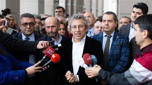 A handout picture released by Turkish Cumhuriyet daily shows Cumhuriyet editor-in-chief Can Dundar (C) speaking to the press before attending a court hearing in Istanbul, Turkey, on November 26, 2015.
