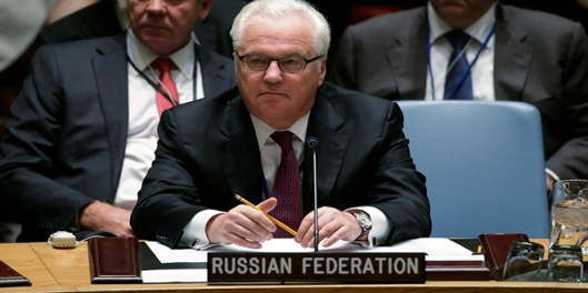 Russia's Ambassador to the United Nations Vitaly Churkin listens to U.S. President Barack Obama (not pictured) speak at the Security Council of the 69th United Nations General Assembly at U.N. Headquarters in New York, September 24, 2014. REUTERS/Brendan McDermid (UNITED STATES - Tags: POLITICS) - RTR47KQ8