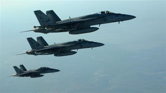 This photo shows a formation of US Navy F-18E Super Hornets in flight after receiving fuel from aKC-135 Stratotanker over northern Iraq, on September 23, 2014. ©AFP