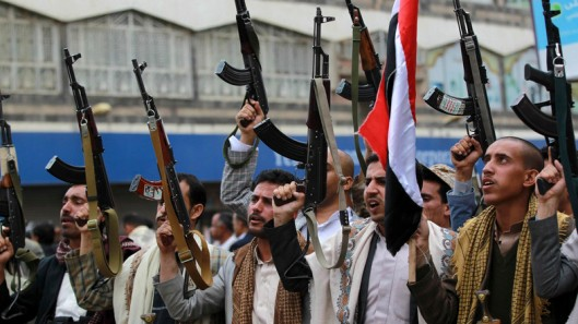 Shiite rebels, known as Houthis, hold up their weapons to protest against Saudi-led airstrikes, during a rally in Sanaa, Yemen, Thursday, March 26, 2015. Saudi Arabia bombed key military installations in Yemen on Thursday, leading a regional coalition in a campaign against Shiite rebels who have taken over much of the country and drove out the president. (AP Photo/Hani Mohammed)