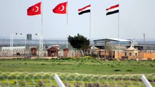 This Tuesday, April 10, 2012, photo shows the border crossing between Turkey and Syria from a refugee camp near the border, in Kilis , Turkey. Turkey's prime minister accused Syria of infringing its border and said Tuesday that his country is considering what steps to take in response. (AP Photo/Germano Assad)