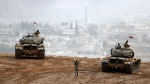 Turkish army tanks-intruding-syria