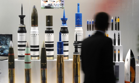 A man looks at tank ammunition at the Defence and Security Equipment International (DSEI) arms fair at the ExCeL centre in east London, on September 10, 2013. The arms fair describes it self as the world's largest fully integrated defence and security exhibition. AFP PHOTO / BEN STANSALL (Photo credit should read BEN STANSALL/AFP/Getty Images)