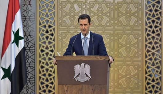 Syrian President Bashar al-Assad addresses the parliament in Damascus