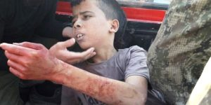 Aleppo-Child-behead-terrorists