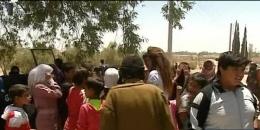 families-people-return-al-Batma-Triangle-Homs-fleeing-ISIS-1