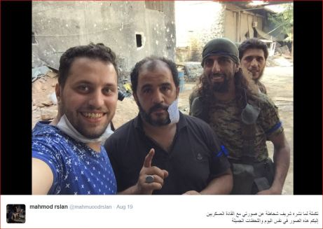"""Mahamoud Raslan with members of the """"Nour al-Din al-Zenki"""" terrorist gang (supported by the USA's administration) responsible for the beheading of the 12-year-old Palestinian boy in Aleppo"""