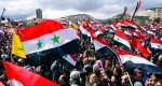 An image released by the official Syrian Arab News Agency shows Syrians rallying in support of President Bashar al-Assad on the first anniversary of the anti-regime revolt. State television showed tens of thousands of people waving Syrian flags and Assad's portrait in squares in Damascus, the northern city of Aleppo, Latakia on the Mediterranean coast, Suweida to the south and Hasaka in the northeast.