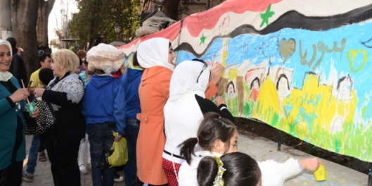 Children of Aleppo paint mural as a message of peace