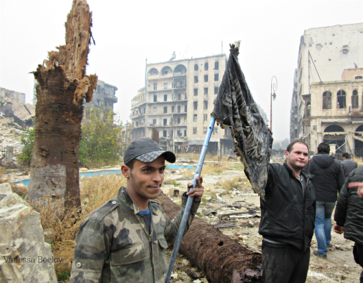 syrian-army-soldier-holds-up-al-nusra-front-flag-aleppo