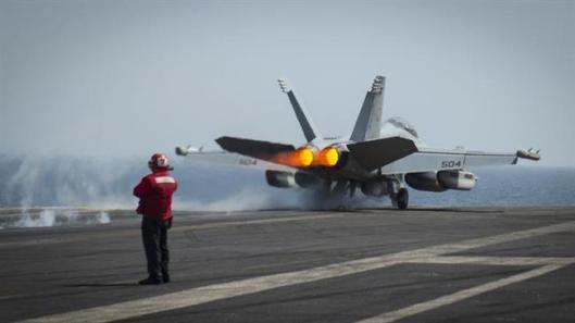 A US fighter jet launches from the USS Carl Vinson on March 19, 2015. (Photo by AFP)
