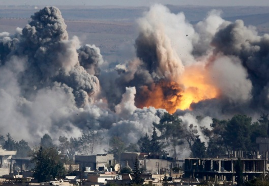 "Smoke rises over Syrian town of Kobani after an airstrike, as seen from the Mursitpinar border crossing on the Turkish-Syrian border in the town of Suruc in this file October 18, 2014 file photo.<br /> A U.S.-led military coalition has been bombing Islamic State fighters who hold a large swathe of territory in both Iraq and Syria, two countries involved in complex multi-sided civil wars in which nearly every country in the Middle East has a stake.<br /> The Turkish military and police had declared the Turkish-Syrian border area a ""military zone"", which limits the ability of the press to move around.<br /> In these days of modern warfare, the weaponry is more powerful than that in the old days. So all of my colleagues and I have to be doubly careful to ensure we do not end up in the line of fire, as positions of Kurdish YPG fighters and IS militants change quickly.<br /> For all those reasons, to stay away is the only solution at the moment.<br /> We ended up on hills about 2km (1.24 miles) away from Kobani using very long telephoto lenses, often more than 1000mm, to get a peek into the city while listening to the sound of war and smelling its scent.<br /> Sometimes you see a shadow of a fighter hiding behind a building and more often you see the massive impact of heavy airstrikes.<br /> It is a bit strange sitting there with lenses I usually use for sports photography alongside people from the area, who come to the hills to see what's going on. They bring binoculars and make tea - making it almost seems like a tourist attraction. - Kai Pfaffenbach REUTERS/Kai Pfaffenbach (TURKEY - Tags: MILITARY POLITICS CONFLICT TPX IMAGES OF THE DAY)<br /> ATTENTION EDITORS: THIS PICTURE IS PART OF THE PACKAGE 'PICTURES OF THE YEAR 2014 - THE PHOTOGRAPHERS' STORY'. SEARCH 'PHOTOGRAPHERS' STORY' FOR ALL IMAGES' - RTR4FOX1"