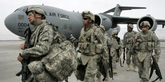 US soldiers arrived from Afghanistan walk outside a plane at the US airbase 30 km outside Bishkek in Manas on February 26, 2009. The soldiers who had been serving with ISAF forces in Afghanistan made a layover on their way to Germany. The United States is still holding out hope for a deal with Kyrgyzstan to avoid the closure of the US military supply base there for Afghanistan even after the Kyrgyz president formalised the shutdown. AFP PHOTO / VYACHESLAV OSELEDKO (Photo credit should read VYACHESLAV OSELEDKO/AFP/Getty Images)
